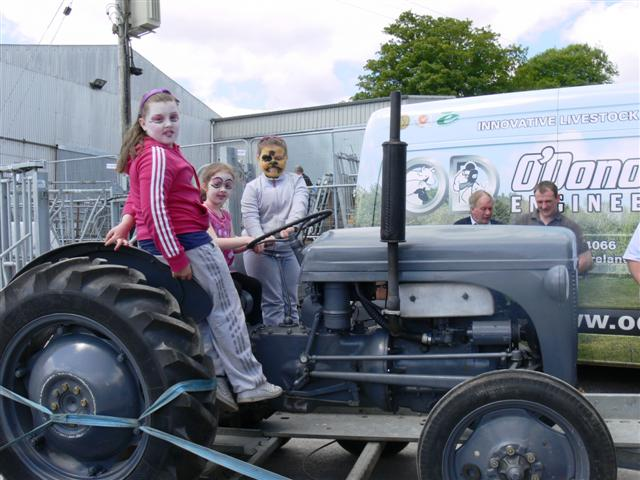 Junior face painting girls on the Broomfield tractor