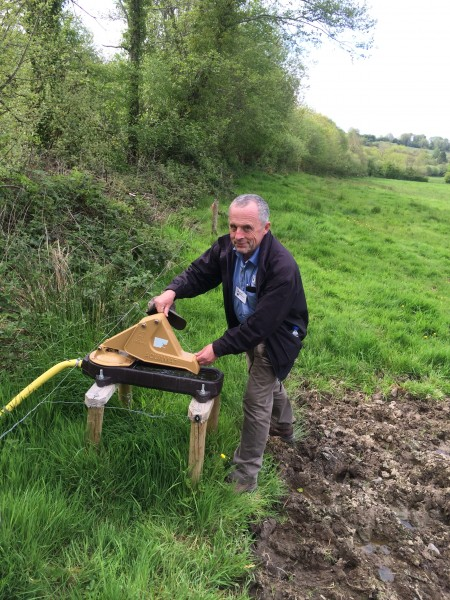 Dermot Donovan getting stuck in giving a demonstration of how the Pasture Pump Works